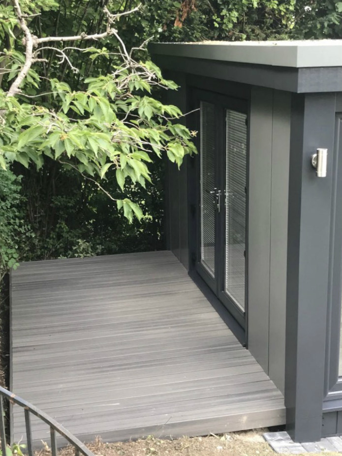 grey decking in fron of garden office