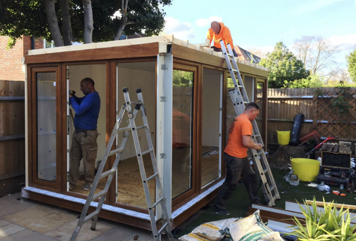 Well oiled machine with 3 fitters installing a QCB garden office