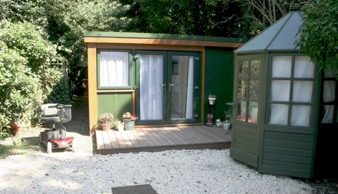 Front of a QC6 granny annexe installed by booths garden studios