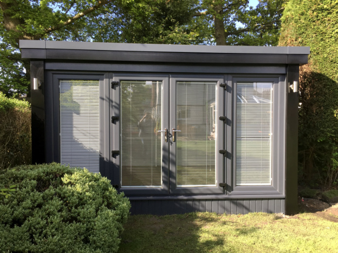 Garden Office With anthracite windows and black corners and fascia